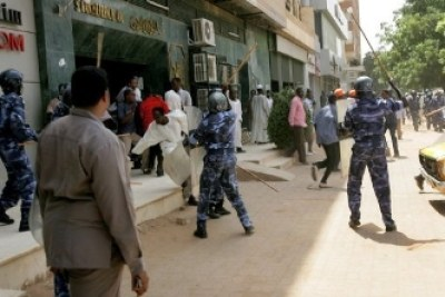 Police beating demonstrators during protests in the capital Khartoum last year (file photo).