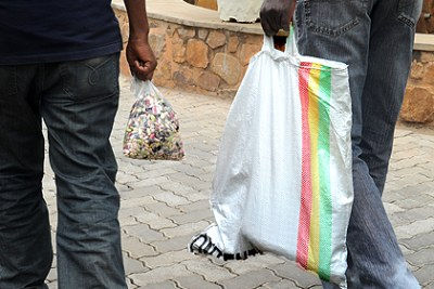 A man carries fresh beans in a plastic bag (file photo).