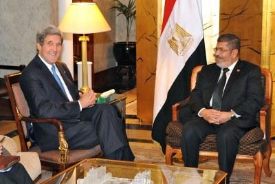 U.S. Secretary of State John Kerry meets former Egyptian president Mohamed Morsi (file photo).