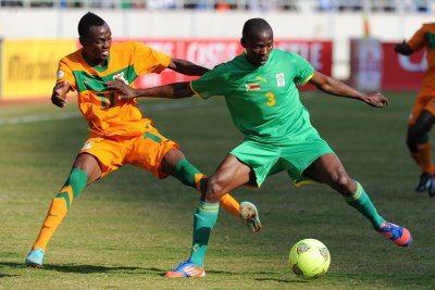 Ocean Mushure of Zimbabwe, in green, is challenged by Mukuka Mulenga of Zambia (file photo).