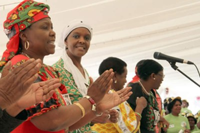 First Lady Amai Grace Mugabe (second from left) flanked by Women's League boss Cde Oppah Muchinguri, Cde Ednah Madzongwe and Cde Olivia Muchena sing in Mazowe where a proposal was made for her to lead the Women's.