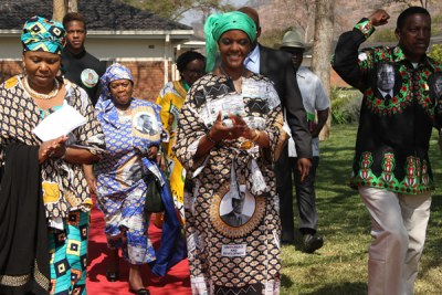 "Oppah Muchinguri (left) seen here with Grace Mugabe (centre) and Zanu PF ""Youth"" Chairman Absolom Sikhosana."