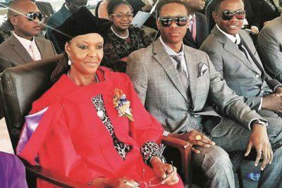 The Mugabes: From left First Lady Grace and her two sons, Robert Jr and Bellarmine Chatunga.