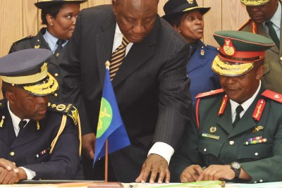 Lesotho security chiefs signing an electoral pledge ahead of the February 2015 polls. The security forces remain unreformed and riven by factional disputes.