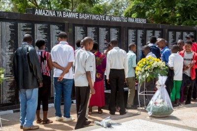 Mourners view names of people who were killed during the 1994 Genocide against the Tutsi that are laid at Rebero Memorial site (file photo)