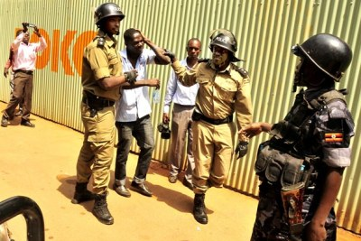 Wavah Broadcasting Services' Lwanga winces in pain after he was clobbered by Old Kampala DPC Joram Mwesigye.