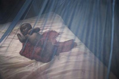 A child under mosquito net to prevent malaria (file photo).