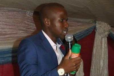 Prophet Lethebo Rabalago holds a can of Doom...