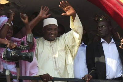 Gambia's President-elect Adama Barrow (C) gesturing to the crowd in Kololi.
