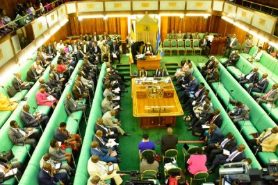 Members of parliament debate during the plenary session recently. Parliament on Wednesday rejected President Museveni's directive on Income Tax Bill.