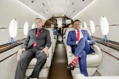 Shepherd Bushiri (right) in his new private jet on his day long trip to Malawi for a worship service.