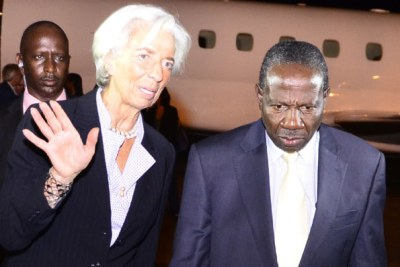 International Monetary Fund Managing Director Christine Lagarde  talks to Finance minister Matia Kasaija at Entebbe International Airport after her arrival in Uganda. Lagarde was in the country at the invitation of President Museveni.