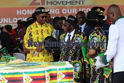 President Robert Mugabe with guests at his 93rd birthday celebrations.