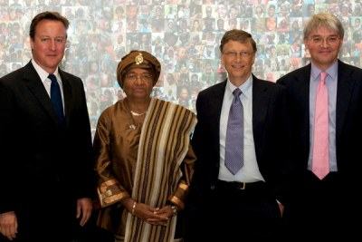 Then British Prime Minister David Cameron, Liberian President Ellen Johnson Sirleaf and then UK Secretary for International for International Development Andrew Mitchell at a 2011 vaccine alliance conference to promote childhood immunizations.