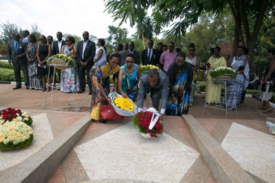 Family and friends lay wreaths on the graves of victims of the 1994 Genocide against Tutsi at a  commemoration event ( file photo)