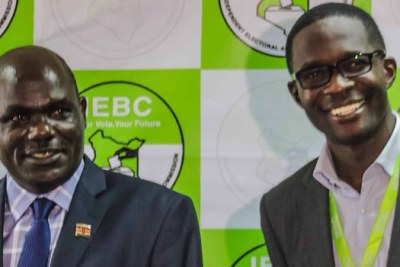 IEBC Chairperson Wafula Chebukati and CEO Ezra Chiloba during happier times (file photo).