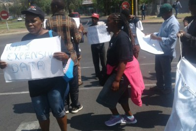 Right2Know protests outside Vodacom, demonstrating against high data and voice call costs.