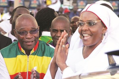 Former First Lady Grace Mugabe greets congregates at a rally.