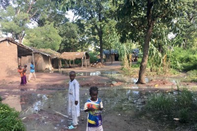 Child refugees from the Central African Republic stand amidst the flooded grounds of the Dosseye refugee camp in southern Chad on September 27, 2017.