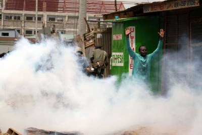 Teargas is used to disperse protesting youths at Baba Dogo area in Nairobi on November 19, 2017.