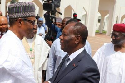 Nigerian President Muhammadu Buhari and President Alassane Ouattara of Cote d'Ivoire