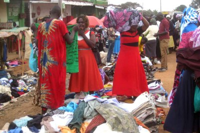 Traders sell second-hand clothes at an open air market in Kenya.