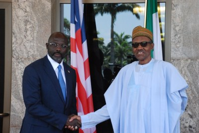 President Muhammadu Buhari, right, met behind closed doors with the visiting Liberian President George Weah.
