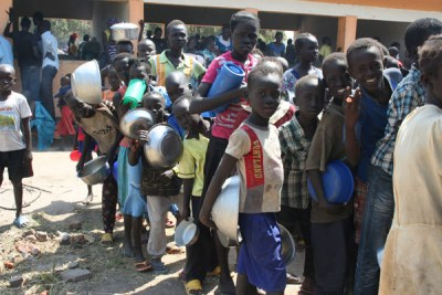 South Sudanese refugees queue for food after arriving at Rhino Settlement Camp in Arua District recently.