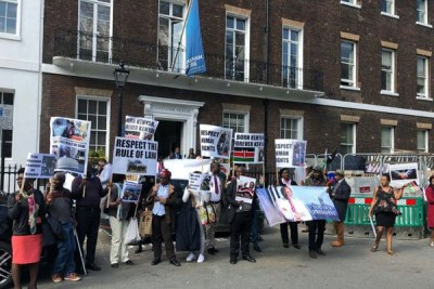 A group of Kenyans protest against President Kenyatta's rule outside Chatham House in London.