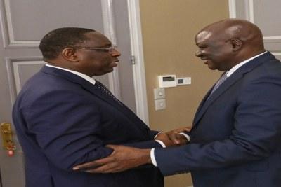 Le président Macky Sall en compagnie  du Premier ministre bissau guinéen Aristides Gomes.