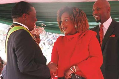 Bona Mugabe greets President Emmerson Mnangagwa at the inauguration ceremony.