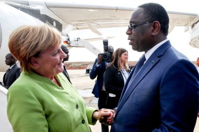 Senegal's President Macky Sall greets German Chancellor Angela Merkel .