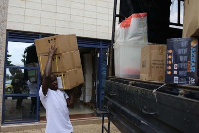 A National Electoral Commission employee loads a truck with materials and equipment that will be used during the parliamentary elections.