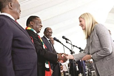 President Emmerson Mnangagwa flanked by  Vice Presidents Constantino Chiwenga and Kembo Mohadi congratulates Youth, Sport, Arts and Recreation Minister, Kirsty Coventry, after taking her oath of office at State House.