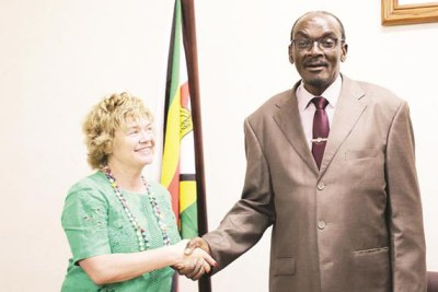 Acting President Kembo Mohadi shakes hands with outgoing British Ambassador to Zimbabwe Ms Catriona Laing as she bade farewell in Harare.
