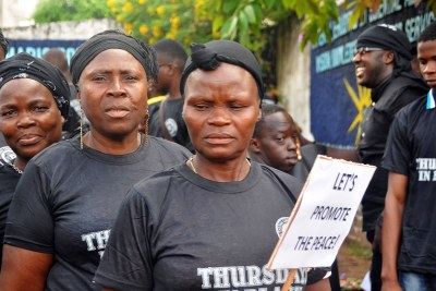 Women of the Lutheran Church in Liberia march against violence in the Thursdays in Black procession.