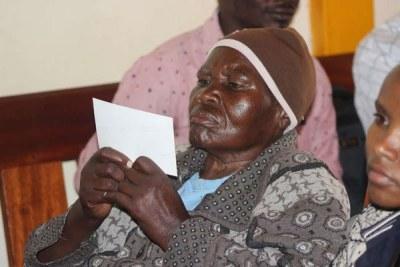 Marcella Mukami follows proceedings at Kangema Court (file photo).