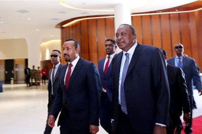 Ethiopian PM Abiy Ahmed, left, and Kenya's President Uhuru Kenyatta attend the Kenya-Ethiopia Trade and Investment Forum in Addis Ababa on March 1, 2019.
