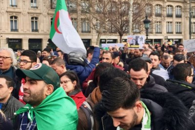 Algerians protested at the Place de la Republique in central Paris against Bouteflika's intention to seek another term in office.