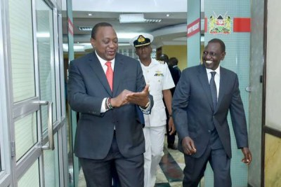 President Uhuru Kenyatta (left) and his deputy William Ruto leave Harambee House Annex after their meeting on March 26, 2019.