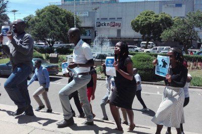 Zimbabwe journalists protest against police brutality.