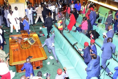 Members of Parliament fight in the Parliament chambers during the last constitutional amendment that sought to remove the presidential age limit in 2017.