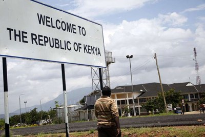 A man crosses into Kenya from Tanzania at Taveta/Holili border post. Dar es Salaam remains opposed to issuance of work permits to Kenyan nationals to work in its territory.