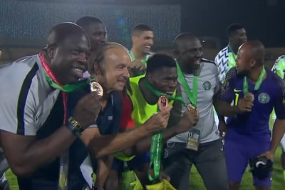 Nigerian players and coaching staff celebrate their bronze medals at AFCON 2019.