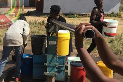 Highfield residents queue for water.