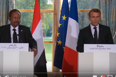 Sudan's Prime Minister Abdallah Hamdok, left, and French President Emmanuel Macron hold a press conference on September 30, 2019.