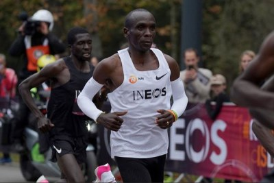 Eliud Kipchoge (in white singlet) runs flanked by pacesetters during the INEOS 1:59 Challenge at Prater Park in Vienna, Austria on October 12, 2019.