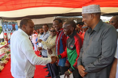 President Uhuru Kenyatta greets world marathon record holder Eliud Kipchoge during the 10th Mashujaa Day fete at the Mama Ngina Waterfront in Mombasa County on October 20, 2019. PHOTO | PSCU