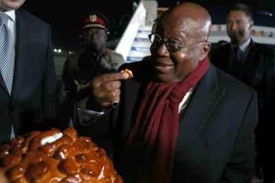Ghana's President Nana Addo Dankwa Akufo-Addo is given a traditional welcome at Sochi International Airport as he arrives to take part in the 2019 Russia-Africa Summit on October 22, 2019.