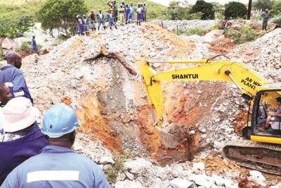Workers try to rescue four miners who are feared dead at Esikhoveni Mine in Esigodini, Matabeleland South Province, on December 11, 2019.